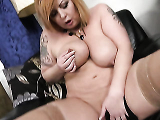 Chubby redheaded girl gets out her toy and plays